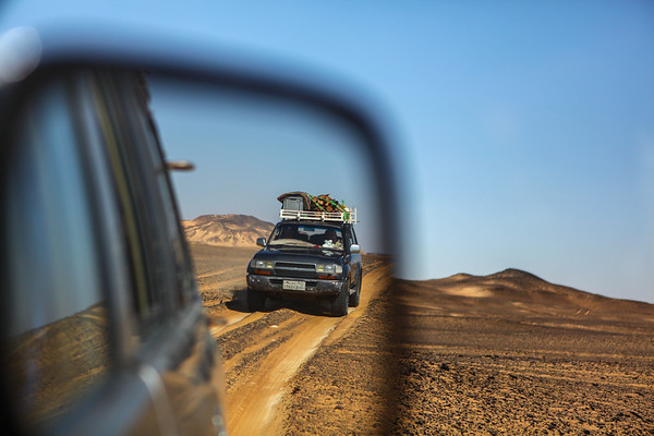 A Car Drives on a Two Track During a Camping Trip in the Western Desert of Egypt