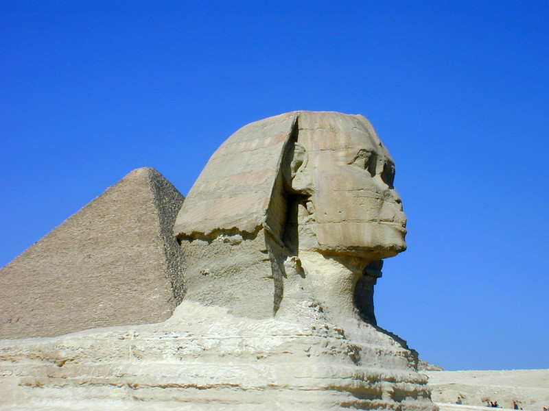 The Sphinx, with the Great Pyramid in the background.