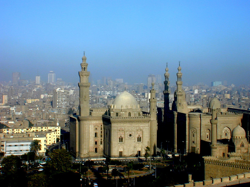 View of Cairo from the Citadel. The mosque at left is the Mosque of Sultan Hassan, while the one on the right is the Mosque of Ar-Rifaye.