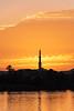 Sunrise silhouettes a minaret along the Nile