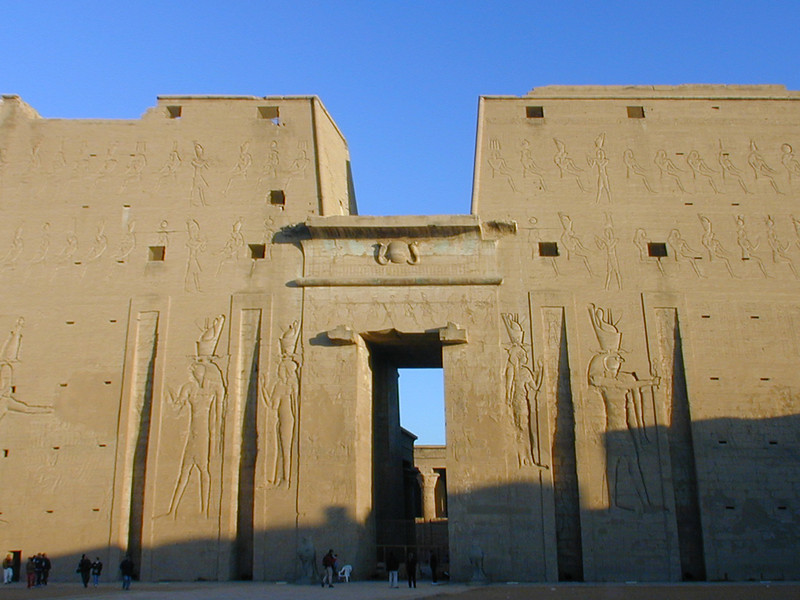 Main pylon of the Temple of Horus at Edfu.This is the best preserved of all of Egypt's ancient temples - and among its largest; it looks like the priests only abandoned the place yesterday.