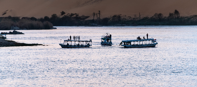 Locals relaxing on the Nile at sunset
