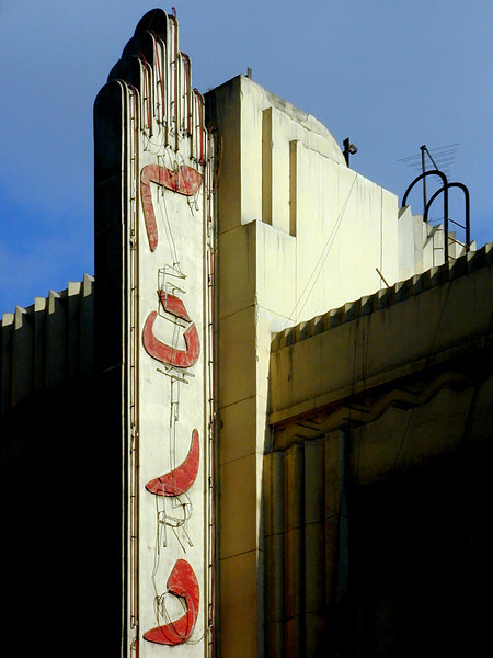 "The faded neon glory of the Metro (phonetically approximated in Arabic on the sign as ""m-t-r-oo"") Cinema, downtown Cairo."