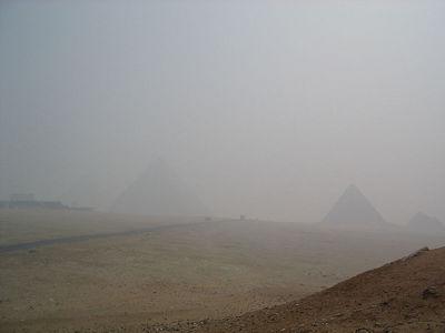Pyramids of Giza through the haze.