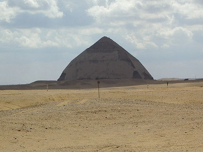 The Bent Pyramid.  They made a mistake.  If they had finished building it at the angle they started with it would have been the tallest of all the pyramids.  Even with the mistake, its only metres shorter than the tallest. Still has most of its limestone covering.