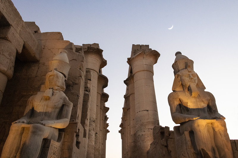 The Crescent moon raises over the Temple of Luxor as the last light of day fades leaving a rosy hue in the sky. The statues of Rameses II are 30 feet tall and the columns are over 50 feet tall. An amazing site to behold. The grandeur of these Egyptian temples was simply breath taking.