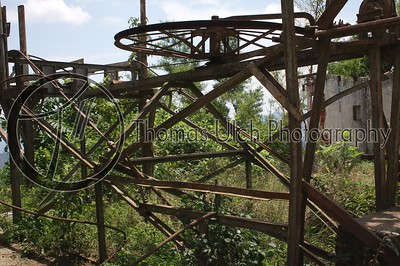 This is at the top of the mountain and in former days it was used as a sort of coffee elevator to move the hundred pound bags from the fields to the trucks. It's use was discontinued as people kept riding on it, falling off and dying. Talnique, La Libertad, El Salvador.