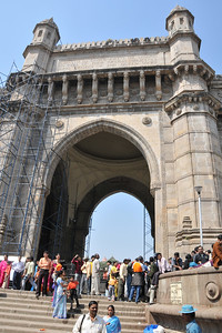 Visitor at Gateway of India boarding the ferry to the Elephanta Caves which are located just off Mumbai harbour .