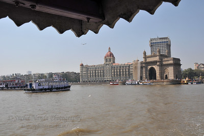 A view of Gateway of India with the Taj Hotel as the back. The Elephanta Caves are located just off Mumbai harbour in the Gharapuri Island also called Elephanta Island - a name given by the Portuguese when they ruled over this area. In 1987, the caves were designated a UNESCO World Heritage Site. Hewn out of solid rock, the Elephanta Caves date back to 600 AD. The caves attract many visitors who take an hour long ferry boat ride to reach from Gateway of India. The cave complex is a collection of rock-cut architecture with stone sculptures of Hindu Gods and Goddesses.
