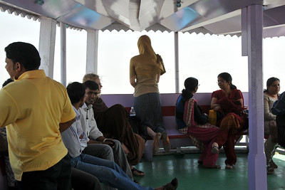 Simple interior of the Ferry carrying visitors to the island. The Elephanta Caves are located just off Mumbai harbour in the Gharapuri Island also called Elephanta Island - a name given by the Portuguese when they ruled over this area. In 1987, the caves were designated a UNESCO World Heritage Site. Hewn out of solid rock, the Elephanta Caves date back to 600 AD. The caves attract many visitors who take an hour long ferry boat ride to reach from Gateway of India. The cave complex is a collection of rock-cut architecture with stone sculptures of Hindu Gods and Goddesses.