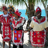 Local folks prepare to perform Junkanoo dances for visitors on the island of Eleuthera, Bahamas, in the Caribbean.