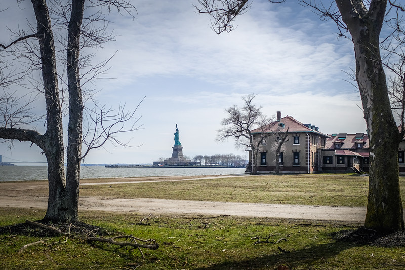 The hospital with Liberty island behind it.