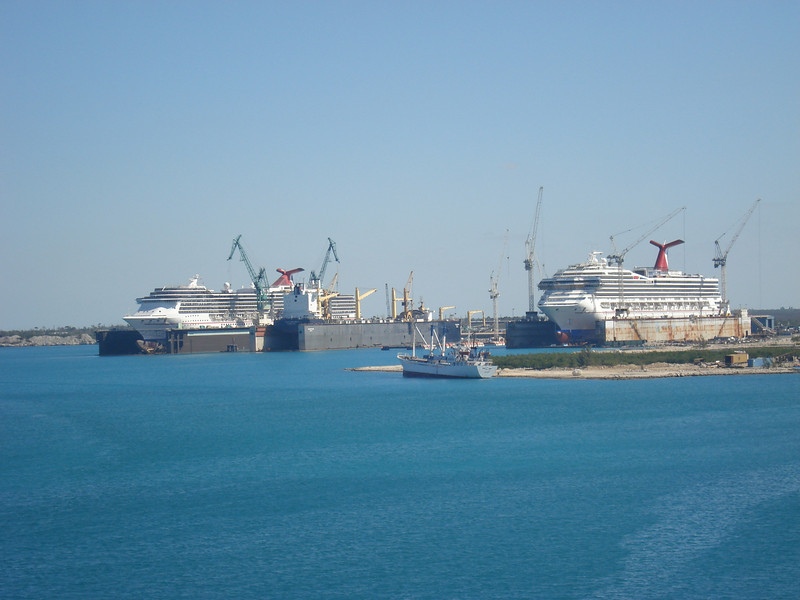 Carnival ships in Freeport drydock for oil change and tire rotation.