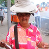 This is the hat lady and she was so sweet, and I had to buy a hat from her. She posed for this picture for me.
