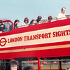 April 1, 1990<br /> London, England<br /> Double decker tour bus--me up top getting off after tour (with sunglasses).
