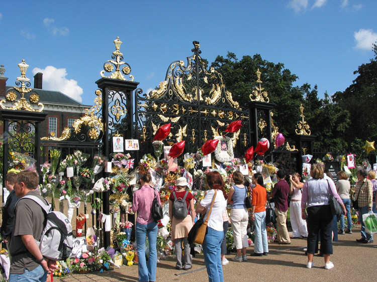 The main gates to Kensington Palace with tributes for the first anniversary of the death of Princess Diana.
