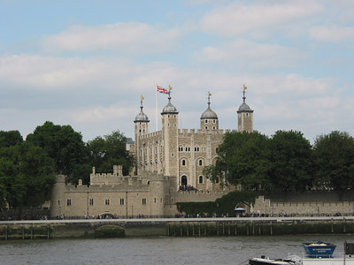The White Tower inside the Tower of London viewed from the oppposite side of the Thames.
