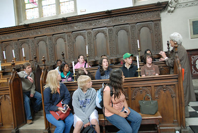 Our tour guide talks about Wadham College as we sit in their chapel.