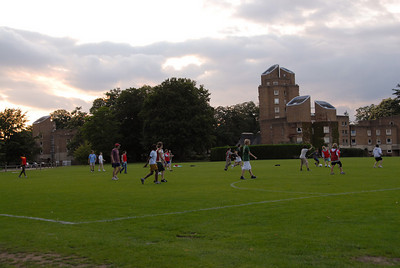 Playing soccer on the pitch (field) outside our dorm.  The boys dorm is in the background.