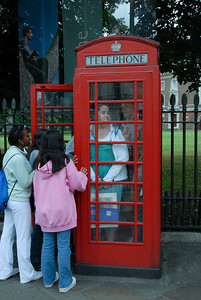Traditional American exercise: fitting everyone into the England phone booth.