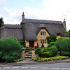 Beautiful example of the Cotswold style: honey-colored limestone and thatched roof. Note the pheasants on the roof!