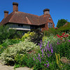 Great Dixter garden with side view of house.