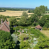 "View from Sissinghurst tower: ""White garden"" with Priest's House on left and fields beyond."