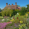 Multiple views of Great Dixter from the gardens.