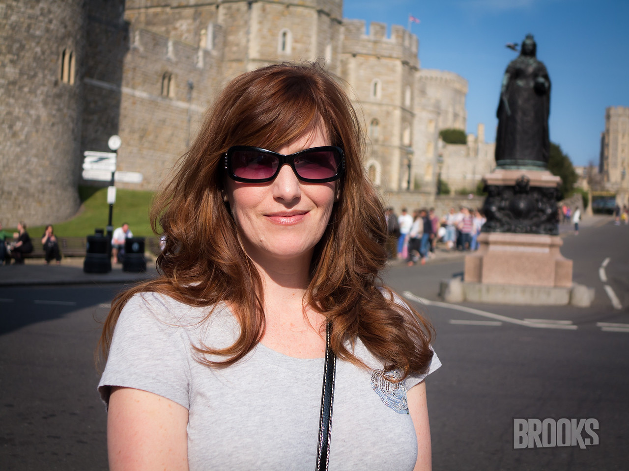 My beautiful wife .. with Windsor Castle and a statue of Queen Victoria in the background