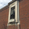 Shackleton sculpture on the Exhibition Road facade of  the Royal Geographical Society. Note staining. 12 May 2016.