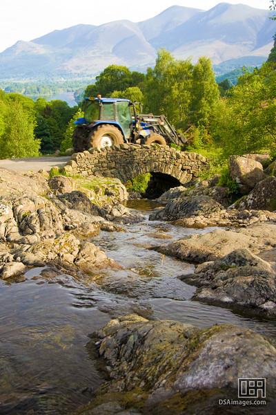 Tractor using an old bridge near Derwent Water, Lake District