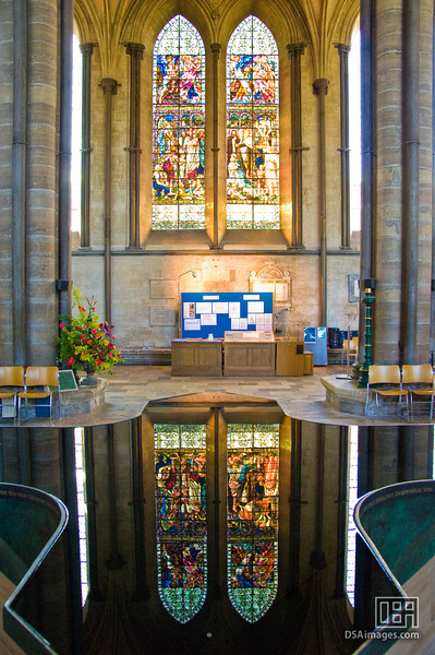 Salisbury Cathedral stained glass windows reflected in the font