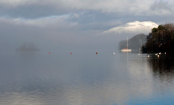Windermere, looking north from Bowness, 23 January 2009 1 - 1022    Heron Pike and Great Rigg, on the western arm of the Fairfield horseshoe, rise above the mist.