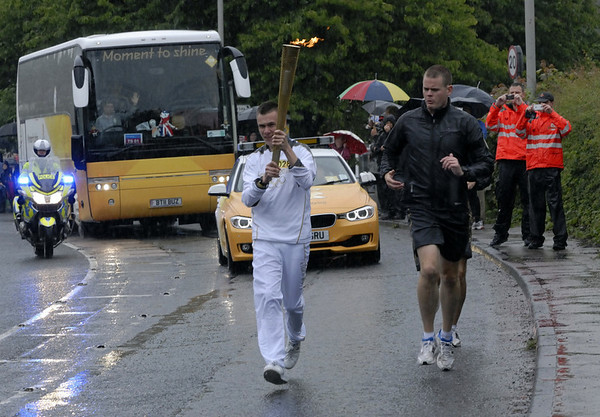 Olympic torch relay, Bolton-le-Sands, north Lancashire, Fri 22 June 2012 7.  And here it is, carried by 19 year-old Matthew Prior, who suffers from epilepsy and autism.