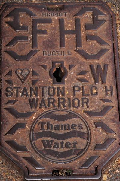 Iron access cover in sidewalk near Regent's Park