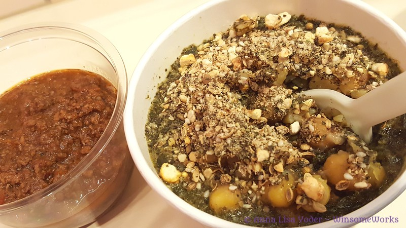 Molohkia - an Egyptian dish with a Freekeh base (young green wheat), meat & greens, & red sauce