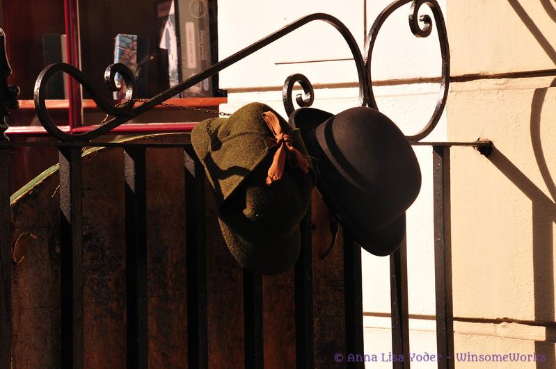 Sherlock Holmes' & Dr. Watson's hats hanging by the apt. door - 221B Baker St.