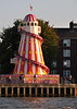 Helter-skelter (a spiral slide around a tower) seen from Thames Ferry - near Greenwich Pier, London