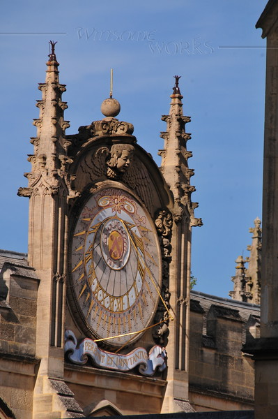 Telephoto view of famous sun dial, seen from St. Mary's - Oxford, London