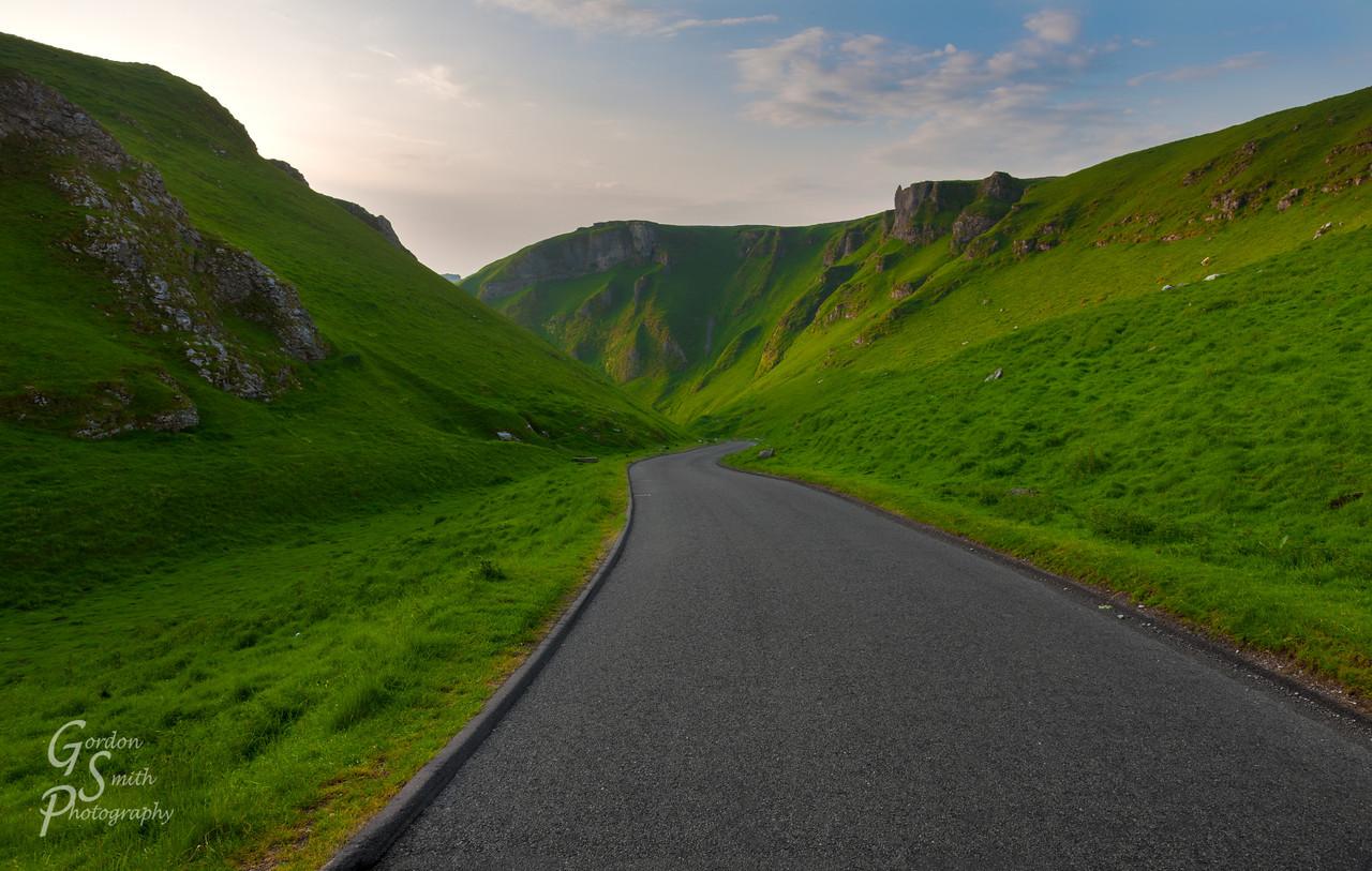Road through green canyon of Winnats Pass, united kingdom.