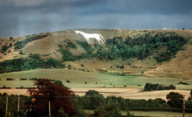 The Westbury or Bratton White Horse on hill side of Salisbury Plain, east of Westbury in England.  Viewed from train going east to London, England.<br /> August 1990.