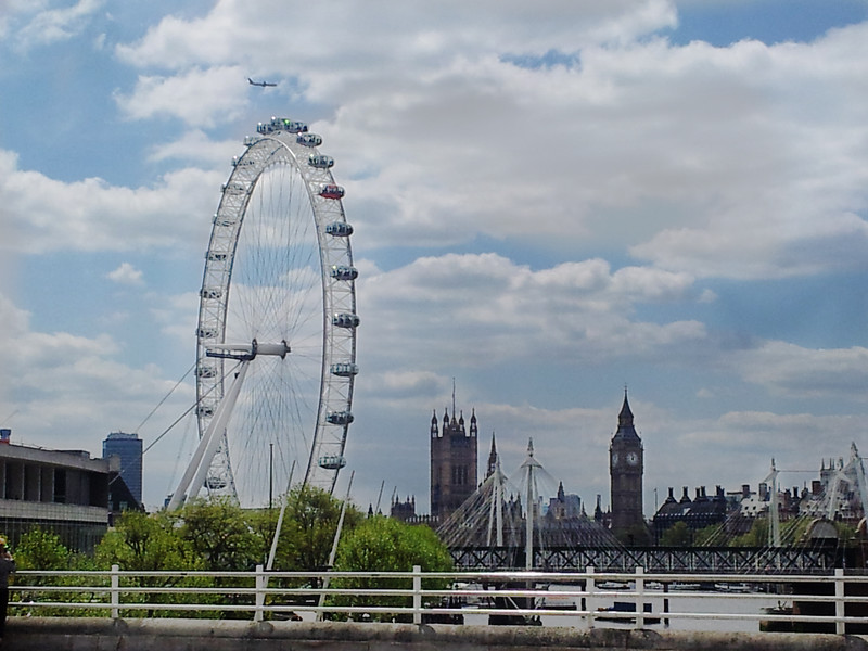 The London Eye, Hungerford and Golden Jubilee bridges and Big Ben, London England