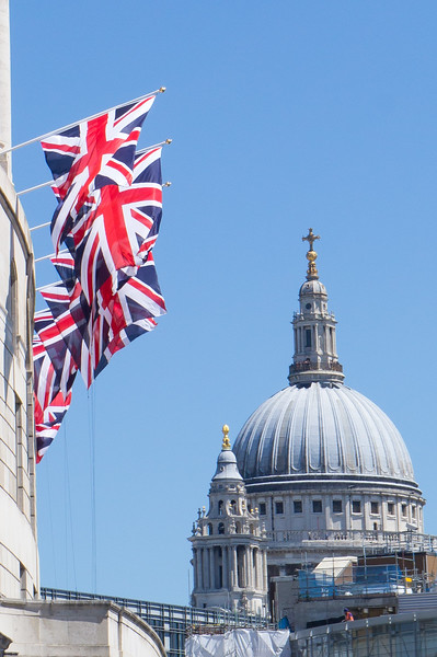 Flags and St. Paul's Cathedral dome, London England