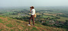 Mike on Glastonbury Tor, Glastonbury, Somerset, England.<br /> August 1990.
