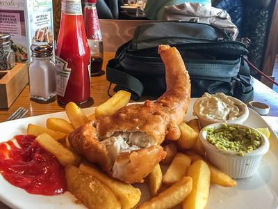 If you're in England you *must* try Fish & Chips at least once! I on the other hand developed a penchant for them. Yes, I used ketchup the first time. But, after that it was malt vinegar all the way ;-)