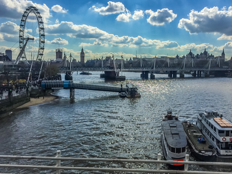 Another view of the London Eye from the Golden Jubilee Bridge, with Westminster Palace and Big Ben in the background.