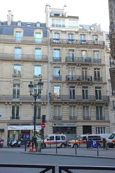 My view from a cafe where I enjoyed my dinner outside. I couldn't help but notice that top-level apartment with its stunning view. In a city like Paris it must be enormously expensive!