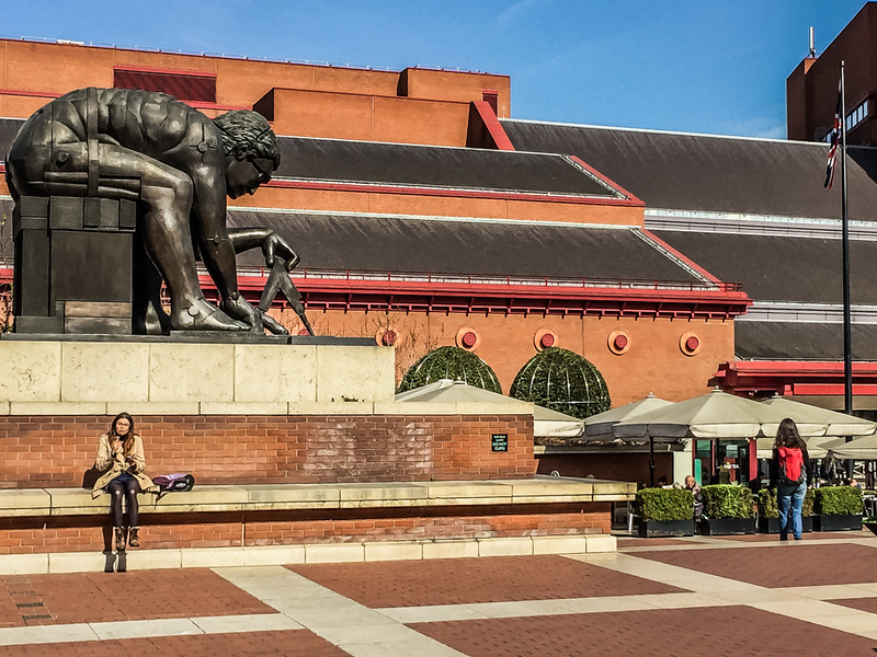 """The British Library. The """"Treasures"""" room is the place to see some of the world's great historical treasures - The Gutenberg Bible, Tyndale's New Testament, a page from Handle's Messiah, and so much more! Unfortunately, no photography is allowed. But, at least you get a view of Issac Newton before entering :-)"""