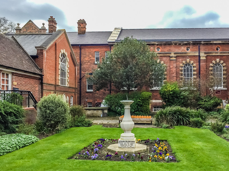 John Bunyan Museum garden.<br /> <br /> Inscription on the pedestal: JOHN BUNYAN; Minister of this church From 1672 to 1688. Baptized Nov. 30, 1628. Died Aug. 31, 1688. Buried at Bunhill Fields London.