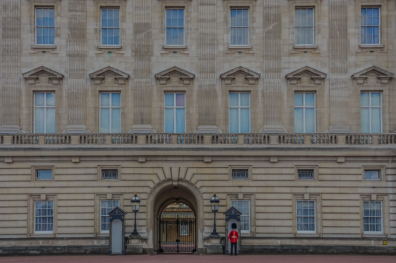 The Queen's Guard standing post outside Buckingham Palace.